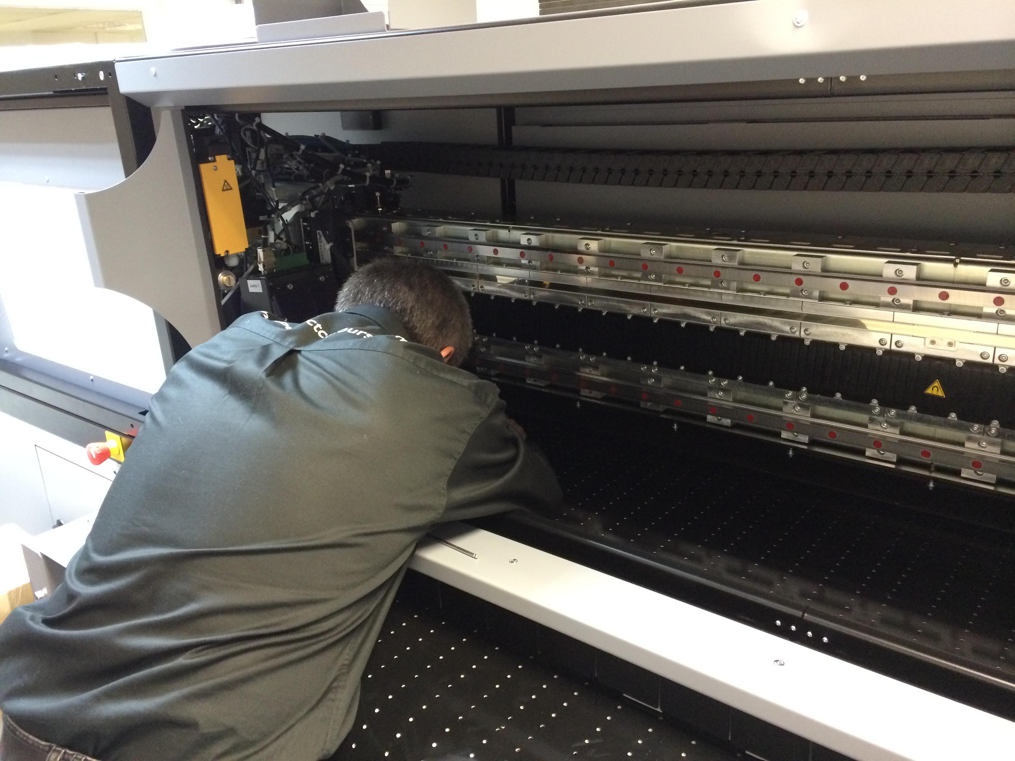 Duncan sticks his head in the machine